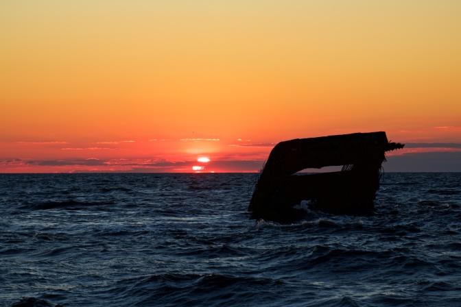 Photo of wreck of SS Atlantus at sunset