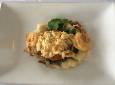 Crab cake with black pepper shrimp on a bed of mashed potatoes for my girlfriend