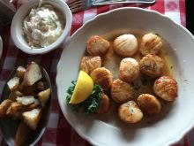Scallops, red potatoes, and coleslaw