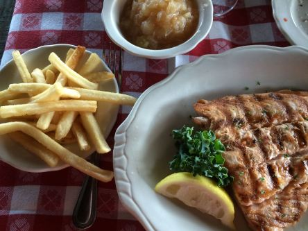 Char-grilled salmon, fries, and applesauce