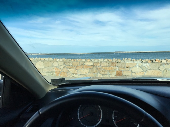 View of Massachusetts Bay through car windshield.