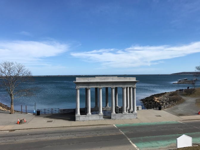 Portico of Plymouth Rock with the Massachusetts Bay in the background.