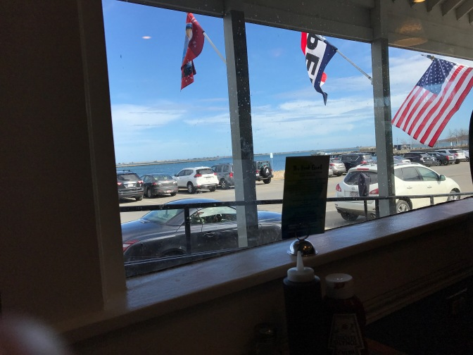 View of the Plymouth shoreline through a restaurant window.