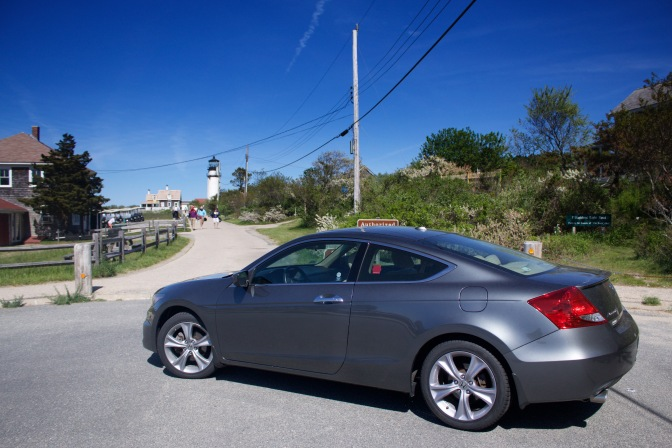 Honda Accord in foreground, Highland Lighthouse in background.