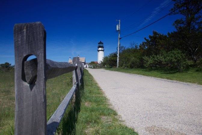 Fence in foreground, Highland Light in background.