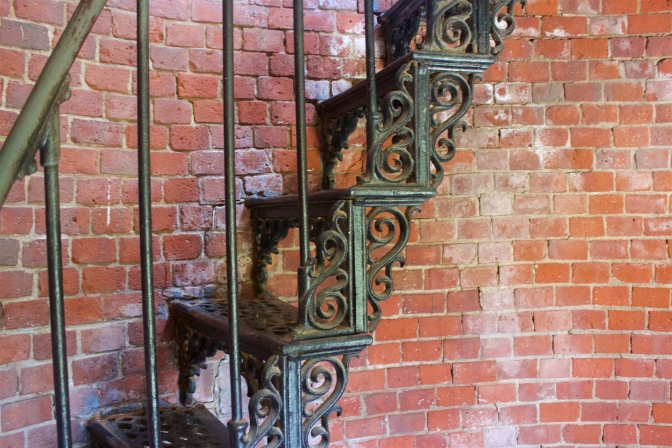 Wrought iron staircase in Highland light.