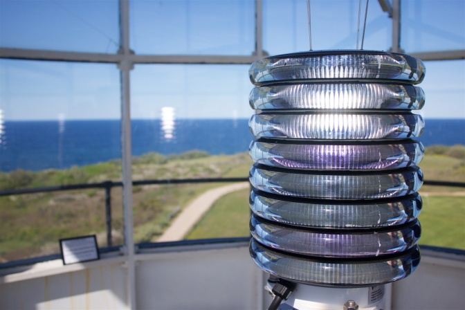 The lighthouse light inside of the lantern room.