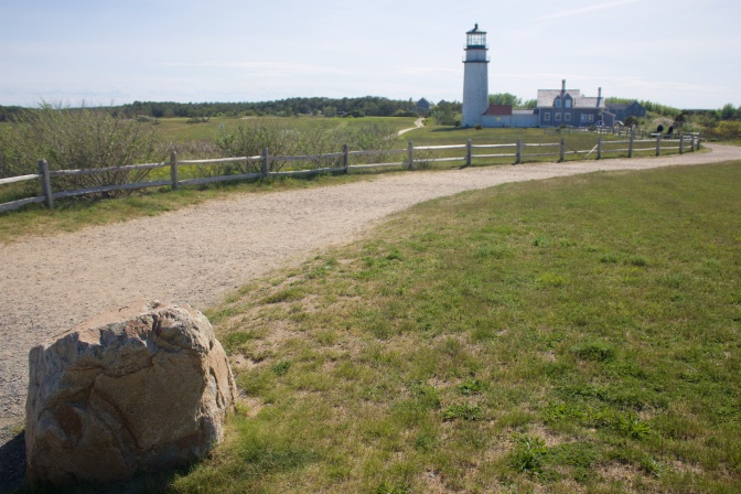 Marker rock in foreground, lighthouse in background.