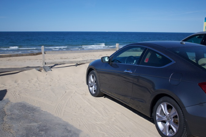 Honda Accord in foreground, beach and ocean in background.
