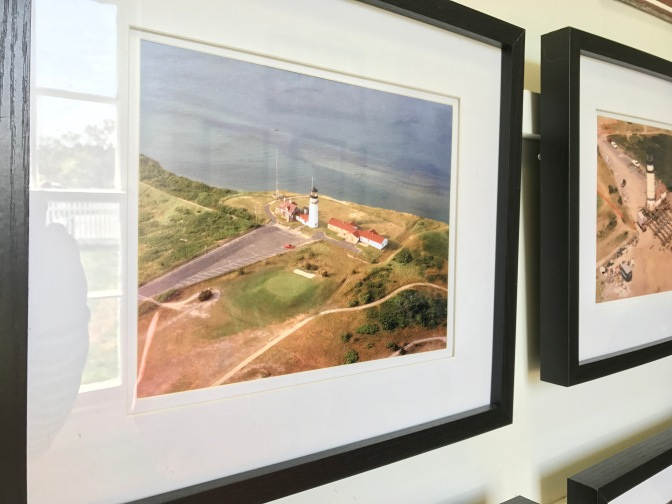 Photograph hanging on wall of aerial shot of Highland Light in 1996.