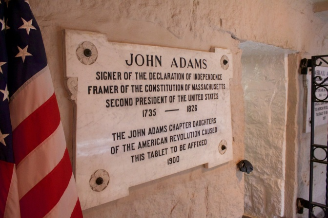Sign indicating the burial place of John Adams in the crypt beneath the church.