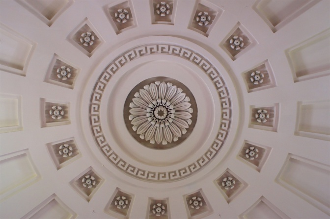 Looking upward at ornate church ceiling.