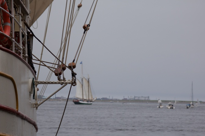 Rigging of Europa, with a sailing vessel in the background.