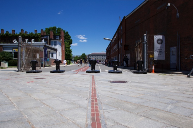 Red brick path of Freedom Trail leading to Boston Navy Yard.