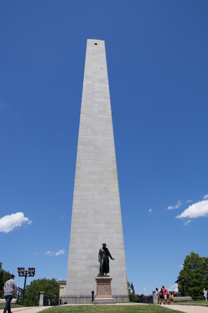 Bunker Hill Monument, with a statue in the foreground.