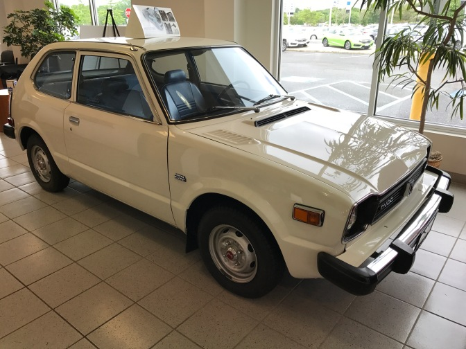 1978 Honda Civic on dealer showroom floor.