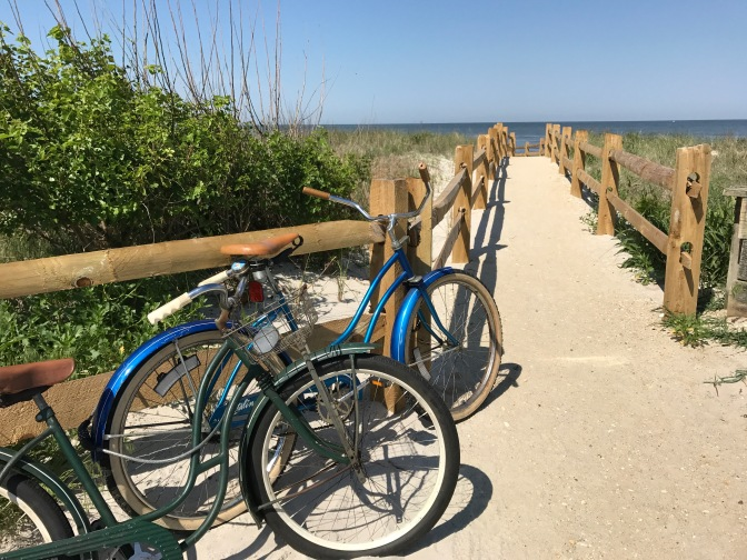 Path to beach, with bicycles in the foreground.
