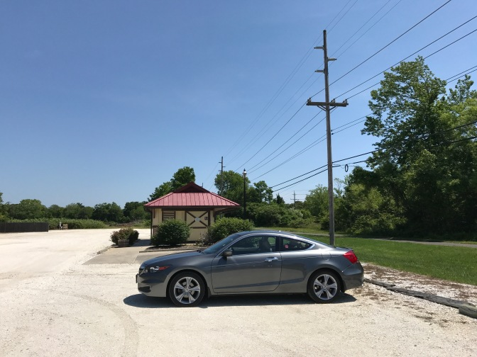 2012 Honda Accord in gravel parking lot.