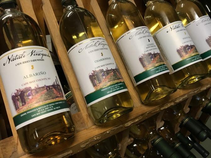 Bottles of wine on racks at Natali Vineyards.