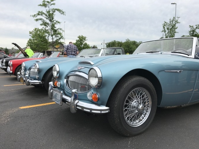 Four Austin Healey 3000 cars.