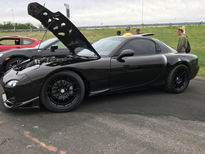 Black Mazda RX7.