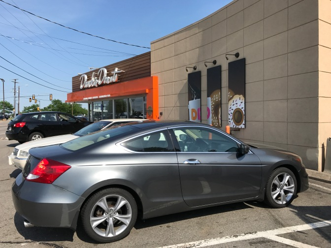 Honda Accord in front of Dunkin Donuts store.