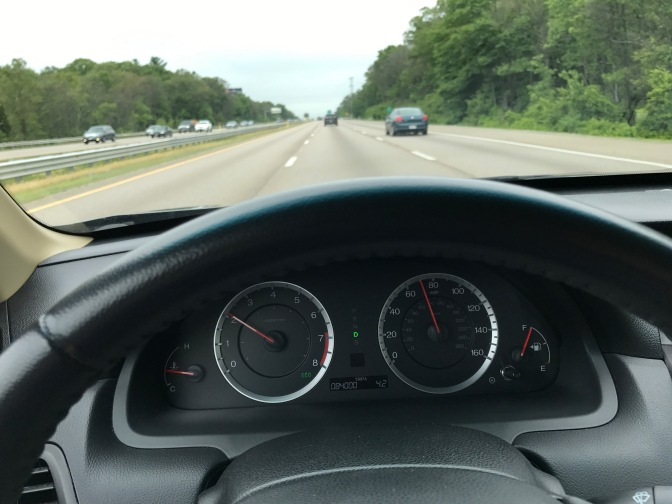 View of Route 24 in Massachusetts, with vehicle dashboard in foreground.
