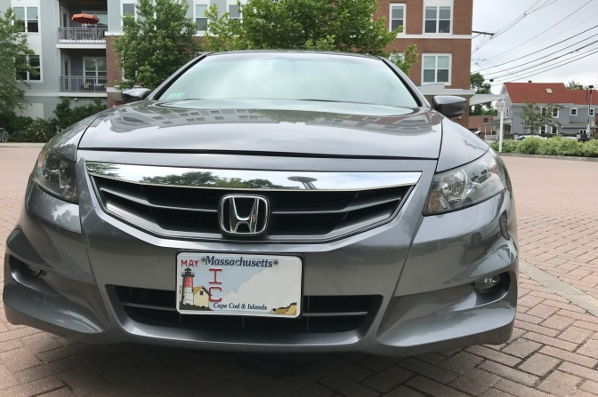 2012 Honda Accord in front of apartment building.