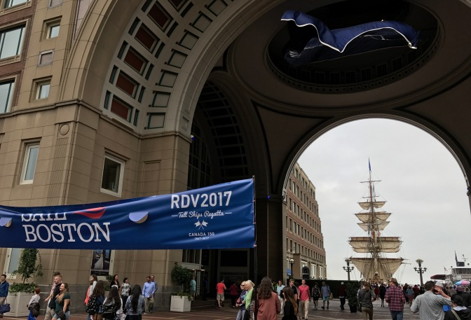 Entrance to Sail Boston, with a tall ship in the background.