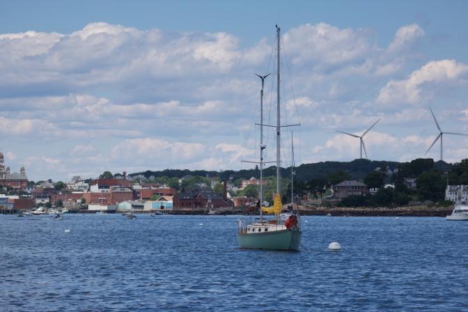 Sailing vessel at anchor near the coast.