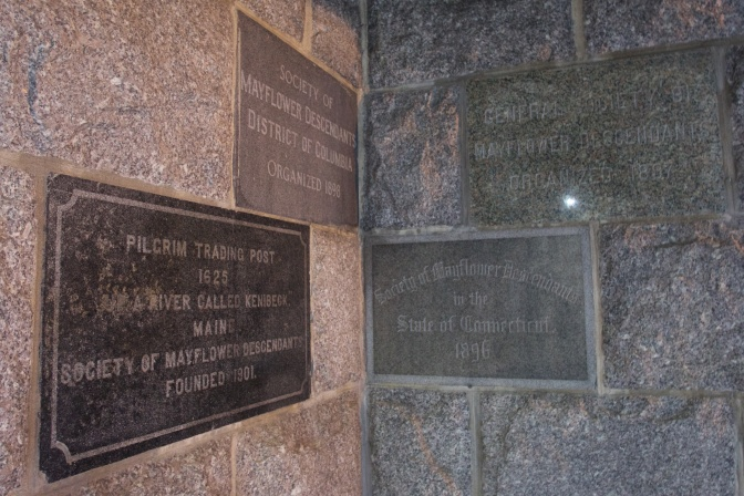 Stone engraved tablets on the walls from different organizations that donated to the construction of the monument.