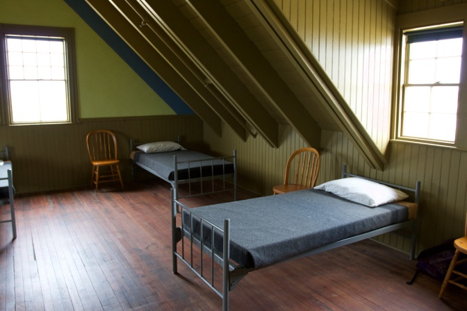 Bunks and chairs in the bedroom for the staff.