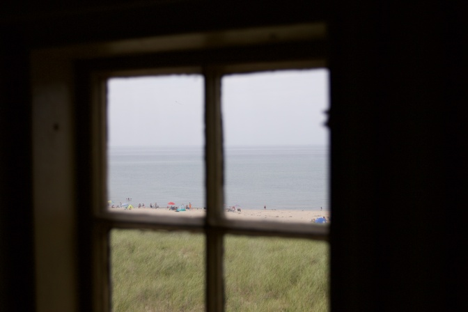 View of beachgoers through one of the station windows.