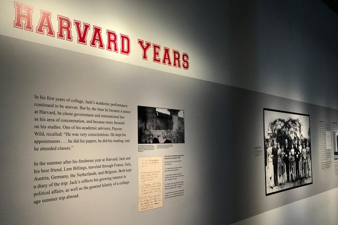 Wall display of John's college years at Harvard.