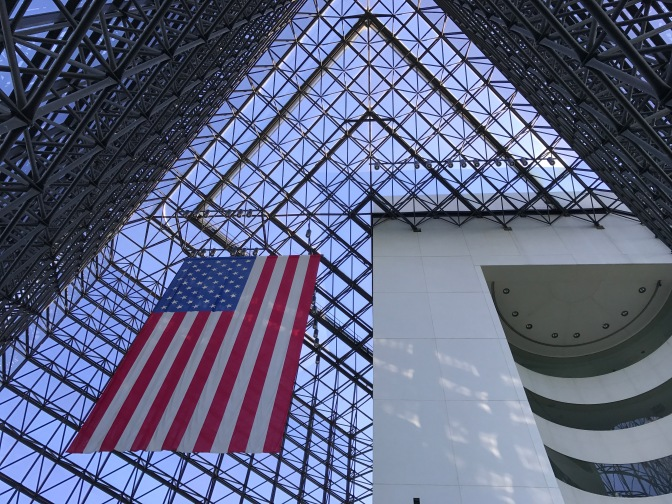 Atrium of Kennedy Library, looking upward toward large American flag.