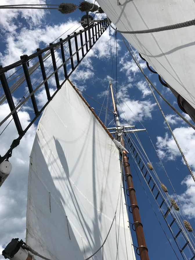 Looking up at fore and main sails.