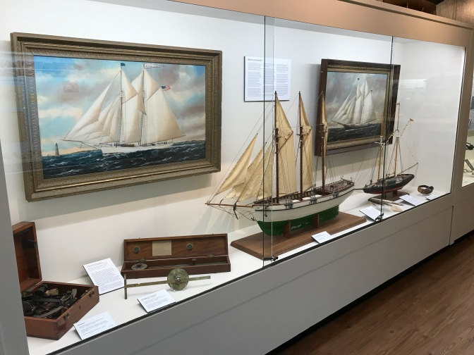 Exhibit on schooners, including two model ships, in the museum.