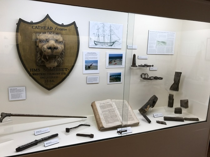 Display on the sinking of the HMS Somerset. It includes pieces of the ship, a book, and several informational panels.