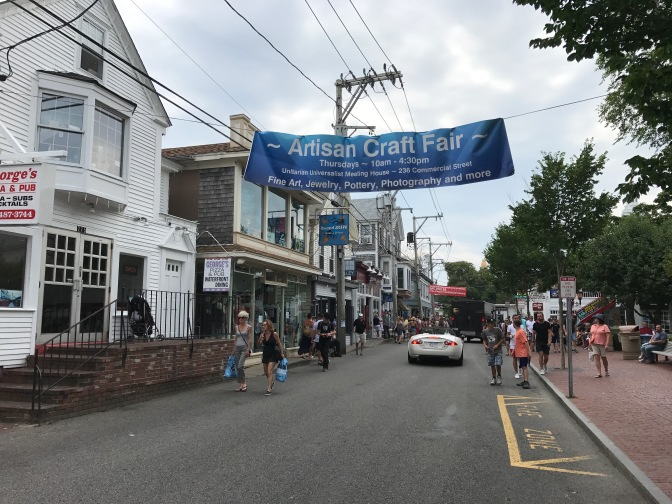 Commercial Street in Provincetown, with pedestrians walking along the street.