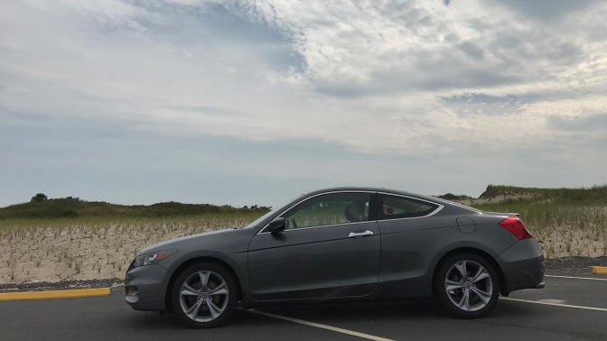 2012 Honda Accord coupe in front of sand dunes.