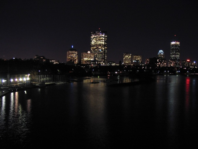 Nighttime view of the Boston skyline.