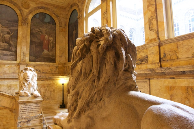 Statues of lions at the mid-point of the main staircase.