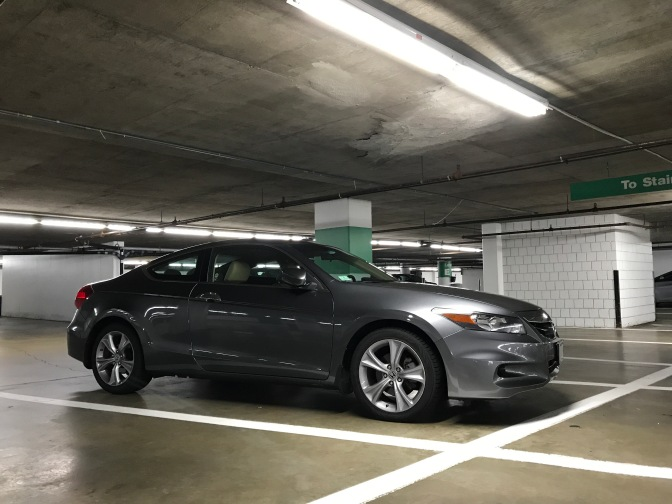 2012 Honda Accord coupe in underground parking garage.