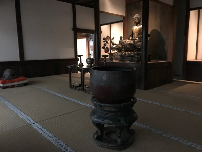 Japanese Buddhist temple. A statue of Buddha is in the middle of the room.