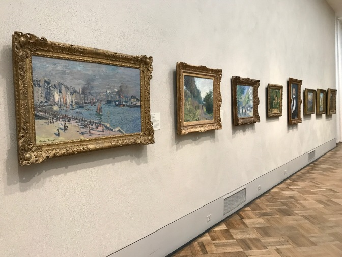 Series of Monet paintings hanging on the wall.