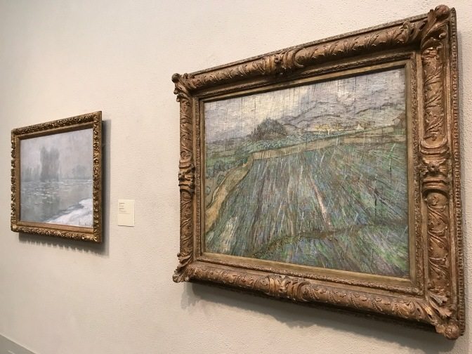 Two paintings by Van Gogh hanging on the wall.