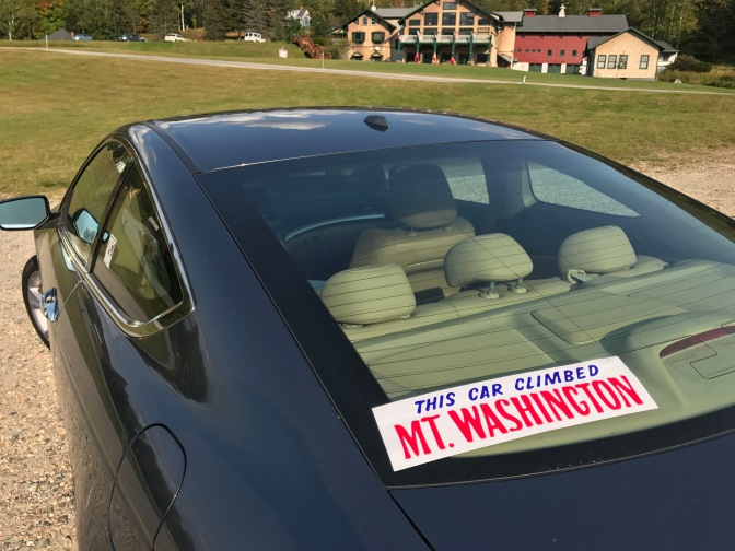 """The Car Climbed Mt. Washington"" bumper stick on the back window of the 2012 Honda Accord."