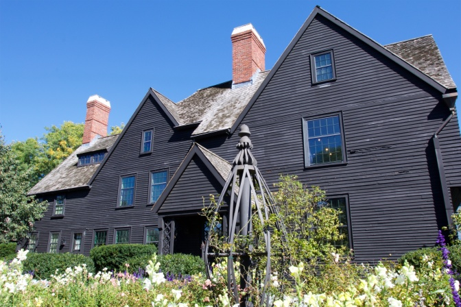 The House of Seven Gables. A garden is in the foreground.