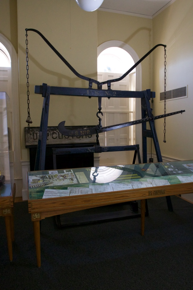 Large iron scale inside the Custom House.