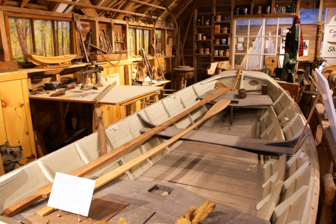Display showing a boat workshop.